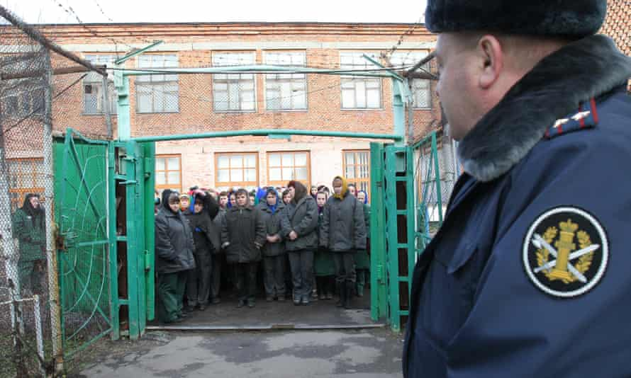 Women wait to be escorted for work detail at a prison outside the city of Orel, central Russia, 2011.