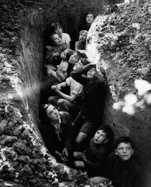 Children of the hop pickers take shelter to watch the Battle of Britain rage overhead in 1940