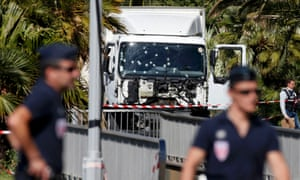 French police secure the area as the scene investigation continues around the lorry involved in the Nice attack.