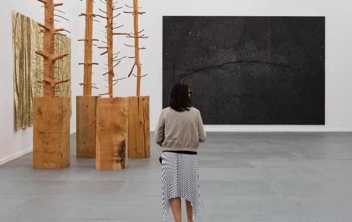 A woman looks at works by Italian artist Giuseppe Penone at Marian Goodman Gallery