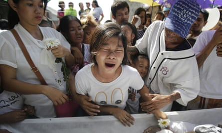 Family and friends grieve as they pay their last respects to alleged drug user Robert Manuel Jnr who was killed by police during an operation. There are calls for President Rodrigo Duterte to be investigate dover his war on drugs which has claimed more than 3800 lives.