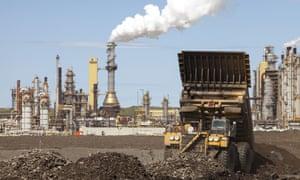 Massive dump trucks by the Syncrude tar sands upgrader plant in Alberta, Canada.