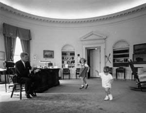 John F Kennedy with his son John Kennedy Jr and daughter Caroline Kennedy in the Oval Office in the White House in 1962