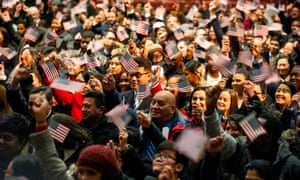 Newly sworn in US citizens celebrate during a naturalization ceremony where 633 immigrants became US citizens on January 22 in Lowell, Massachusetts.