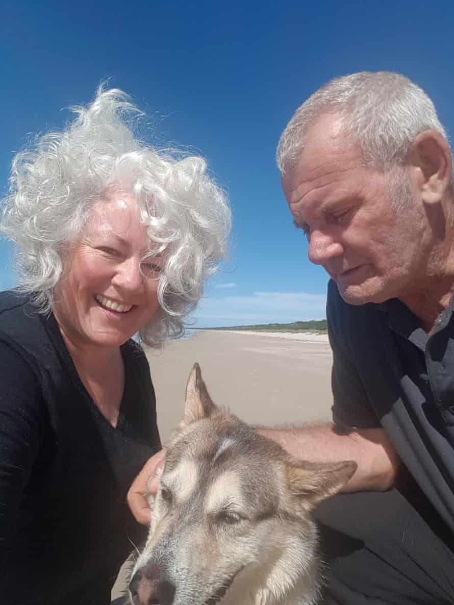 Annetta Mallon, her husband Pete and their dog, Cully on Seven Mile Beach in north-west Tasmania.