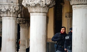 Policemen stand in front of the Venice's Doge's Palace in Venice in January.