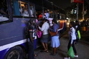 Evening passengers climb on board a matatu