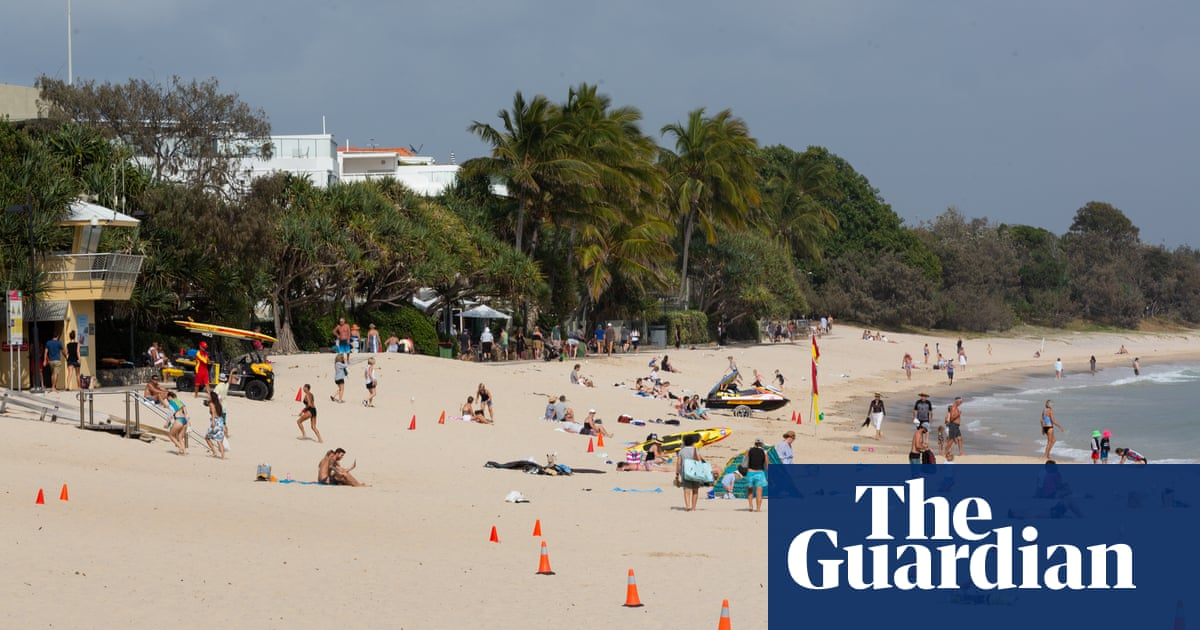 Two men drown and child in hospital in Queensland beach tragedy – The Guardian
