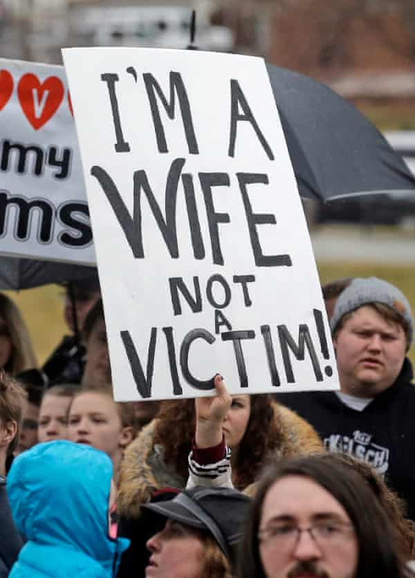 Polygamy supporters hold signs during a rally at the state capitol Friday in Salt Lake City in 2017.