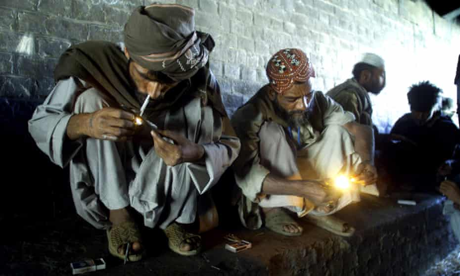 Men smoking heroin in Quetta, Pakistan, near the border with Afghanistan.