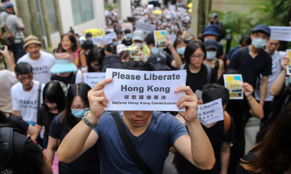 Hong Kong activists march to call for for foreign support for their fight against a controversial extradition bill.