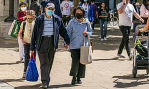 Shoppers in Wimbledon wearing protective face masks.