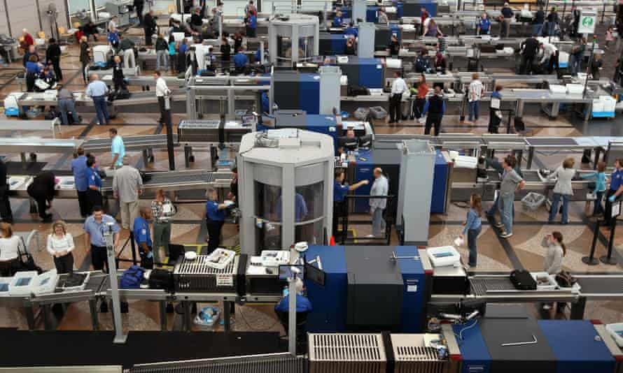 Air travelers move through a main security checkpoint at the Denver international airport. Travelers found with marijuana are asked to dispose of it in one of the airport's 'amnesty boxes'.