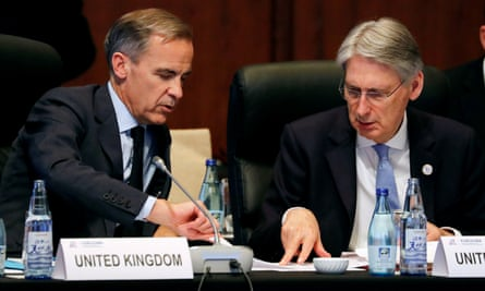 Final tasks: Bank of England Governor Mark Carney with Chancellor Philip Hammond during the G20 meeting in Japan this month.