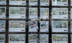 Houses for sale in estate agent's window