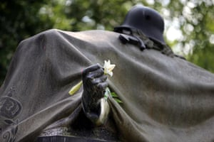 A white lily lies on a first world war monument in a burial ground of the garrison cemetery in Berlin