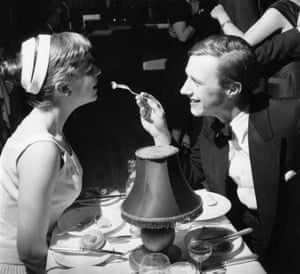 Designer and restaurateur Terence Conran feeds a morsel of food to his wife Shirley in a restaurant in 1955.