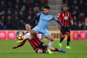 Sergio Agüero is challenged by Adam Smith.