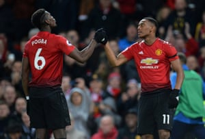 Pogba and Martial celebrate.