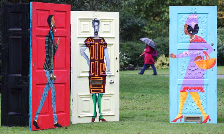 A woman walks past Lubaina Himid's artwork Five Conversations in Regent's Park, London