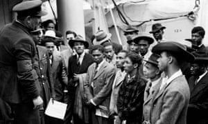 Jamaican immigrants are welcomed by RAF officials after the Empire Windrush landed at Tilbury in 1948.