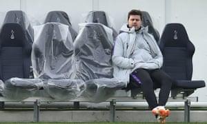 Tottenham Hotspur's head coach Mauricio Pochettino keeps an eye on his players at Tuesday's training session.