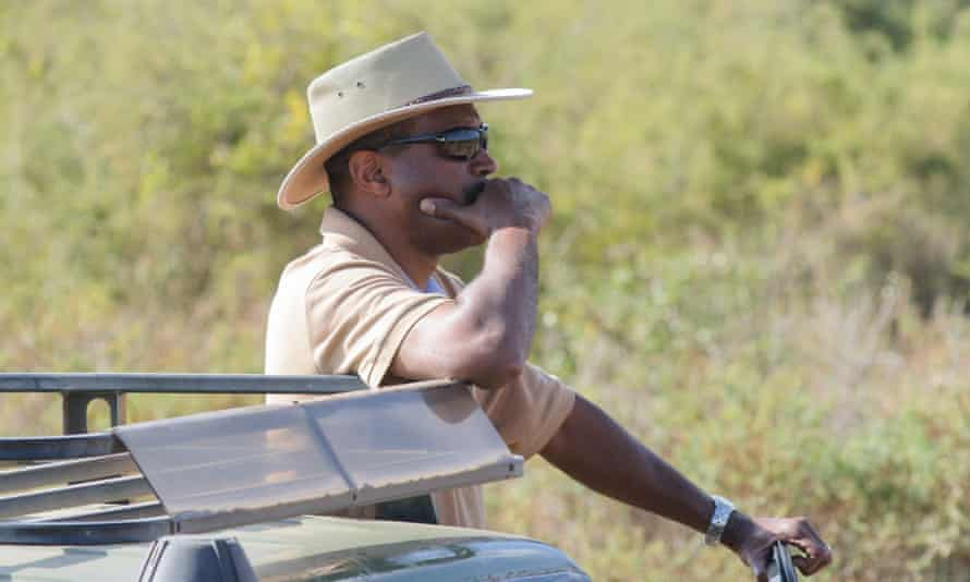 Kenya Wildlife Service Director General Kitili Mbathi looks on anxiously during operations to fit a tracking collar to elephant Tim in Amboseli National Park on 10 September 2016.