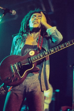 Bob Marley performs on stage with the Wailers at Houtrust Hallen in The Hague, Netherlands, playing a Gibson Les Paul Special guitar.