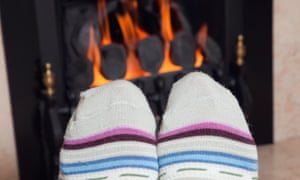 Person warming their feet in front of a fire