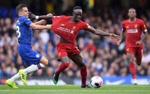 Sadio Mane of Liverpool is tackled by Cesar Azpilicueta of Chelsea.