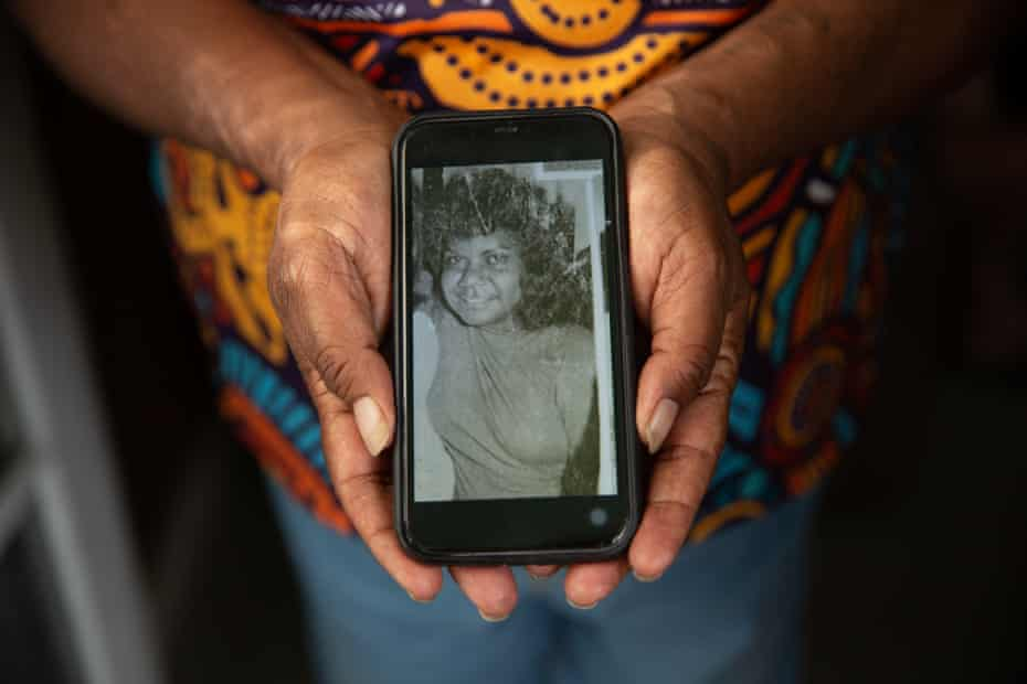 Debbie West, Queenie Hart's niece, holds a photo of her aunty