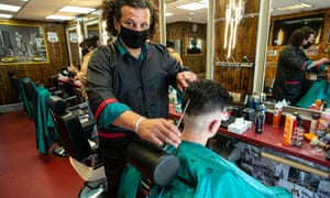 Nazime Bendjabar giving customer a haircut