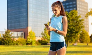 Woman with mobile in sporty clothes