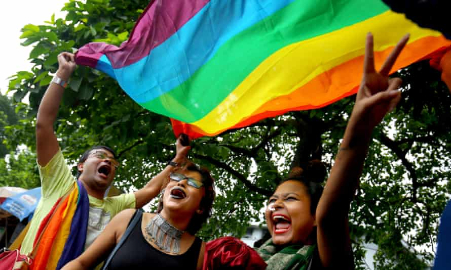 Activists from India's LGBT community in Kolkata celebrate their country's ruling that gay sex is no longer a criminal offence