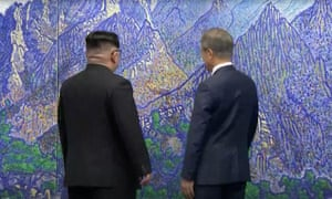 Kim and Moon admire a painting of Mount Kumgang in the summit meeting room.