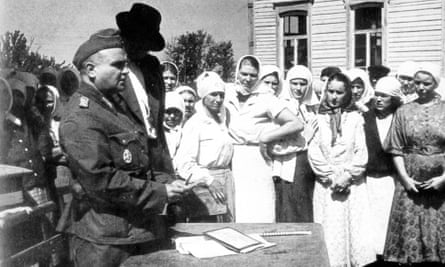 Residents of a Ukrainian village are registered by Wehrmacht representatives, 1941.