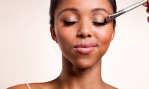 Woman having makeup applied