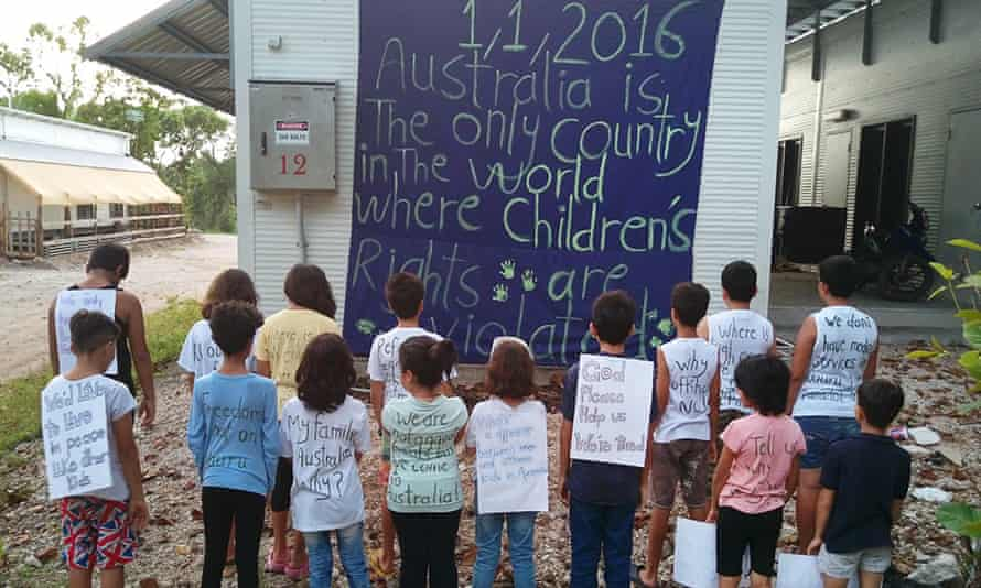 Children from the refugee and asylum seeker community on Nauru take part in a protest against Australia's immigration policies in 2016. This week the last remaining children were moved off the island.