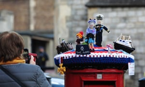 A knitted Postbox Topper depicting the Queen and her late husband Prince Philip ready for Saturday's funeral, Windsor