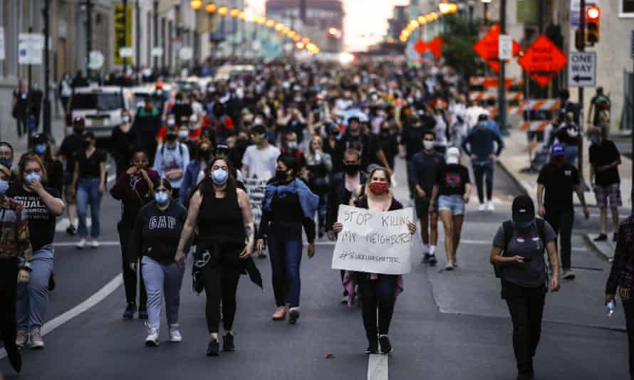 Demonstrators march in Philadelphia to protest the death of George Floyd.
