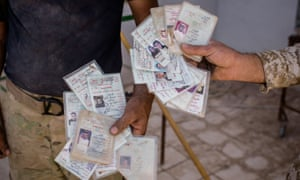 Partially cut Iraqi ID cards were found by the PMF forces