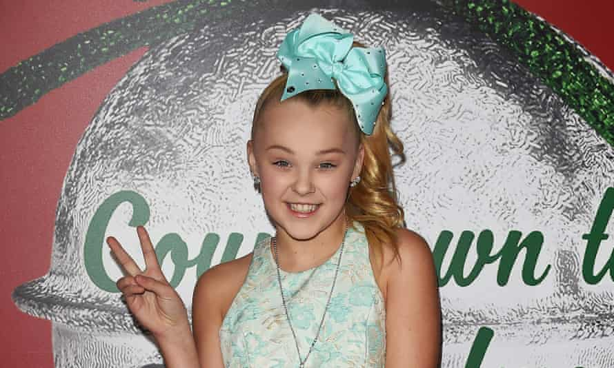 JoJo Siwa's famous bows have been outlawed in schools.