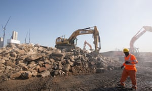 building site with rubble diggers and workman in hi-vis