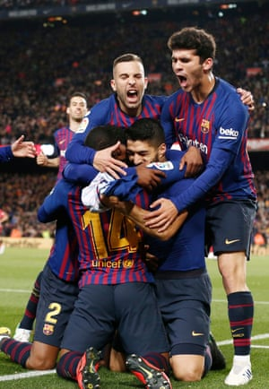 Luis Suárez is mobbed by his teammates after finally breaking the deadlock.