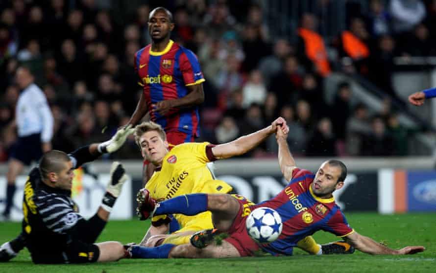 Javier Mascherano makes the tackle on Nicklas Bendtner