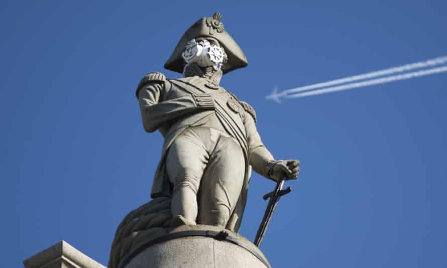 an air mask placed on the statue of lord nelson in trafalgar square by greenpeace activists, london, in april 2016