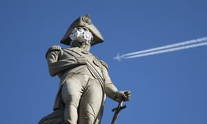 Nelson's statue in central London wears a mask after Greenpeace action highlighting air pollution.