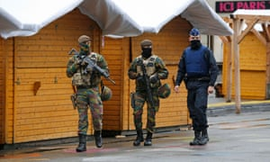 Belgian soldiers patrol in central Brussels after security was tightened in Belgium following the fatal attacks in Paris.