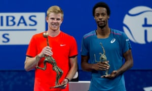 Kyle Edmund (left) holds his first ATP trophy after beating Gaël Monfils to claim the European Open in Antwerp.