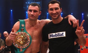 Vitali Klitschko with his brother Wladimir after a successful title defence in 2012